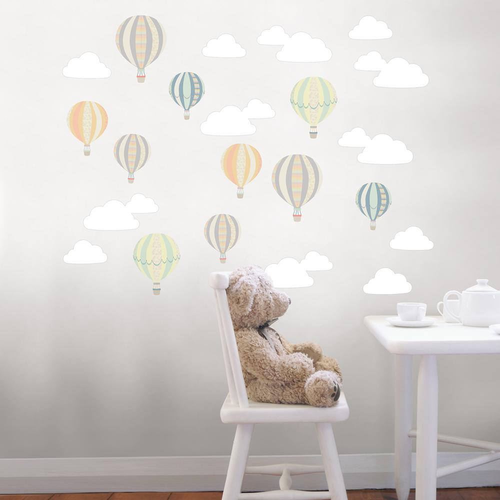 Wall Pops Multi-Up and Away Wall Decal, Multi-Color Add whimsy to a nursery with air balloons and clouds. These decals would be especially perfect for a wanderlust or travel themed nursery. Up and Away Wall Art Kit Wall Art Kit contains 22-pieces on 4-sheets that measure 17.25 in. x 9.75 in. Color: Multi-Color.