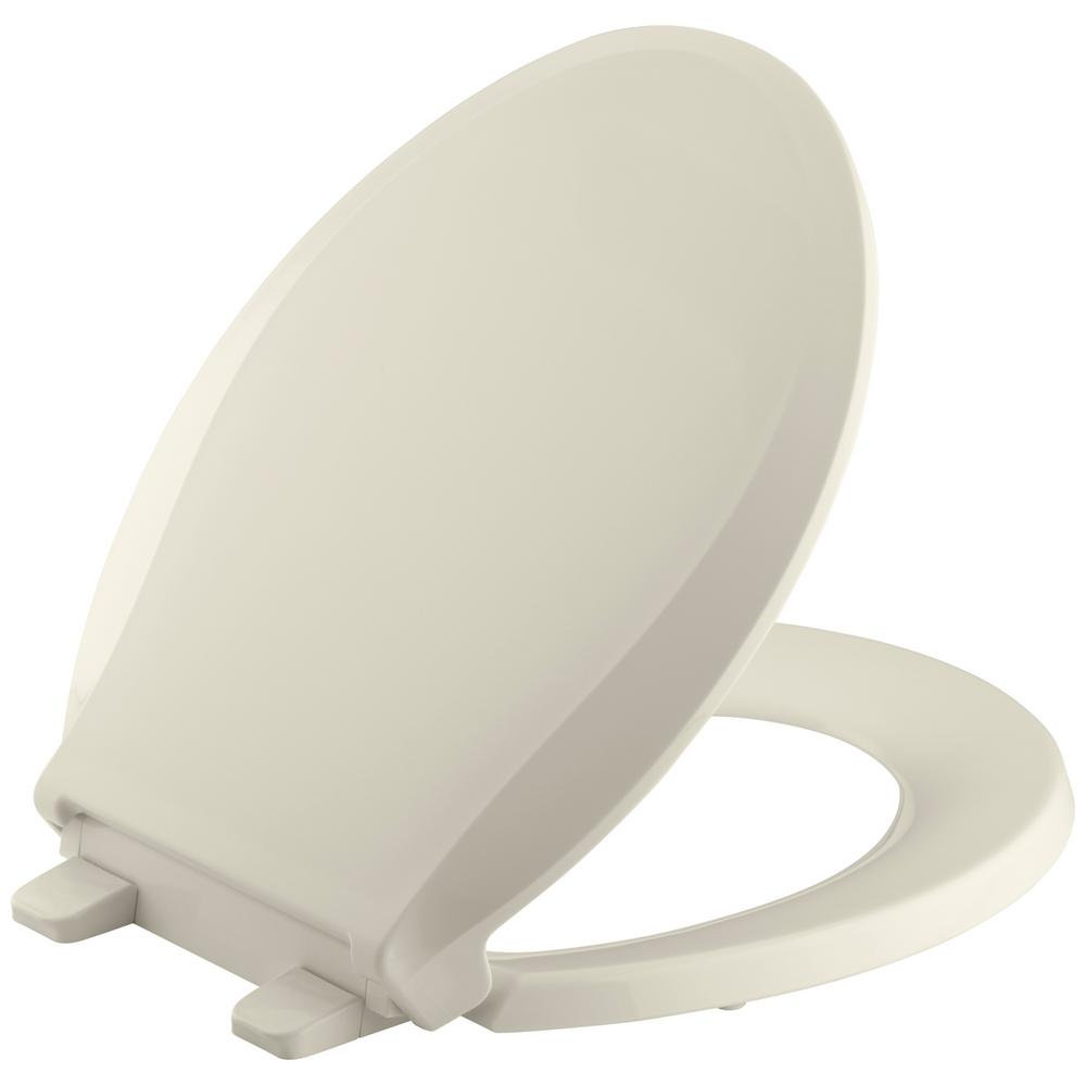 KOHLER Cachet Quiet-Close Round Closed Front Toilet Seat with Grip-tight Bumpers in Almond