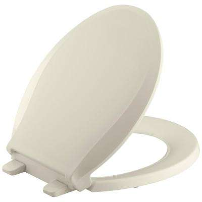 Cachet Quiet-Close Round Closed Front Toilet Seat with Grip-Tight Bumpers in Almond