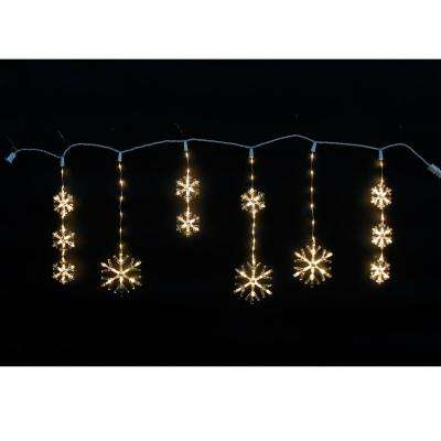 Indooroutdoor icicle lights christmas lights the home depot 150 light warm white micro dot led snowflake icicle light aloadofball Gallery