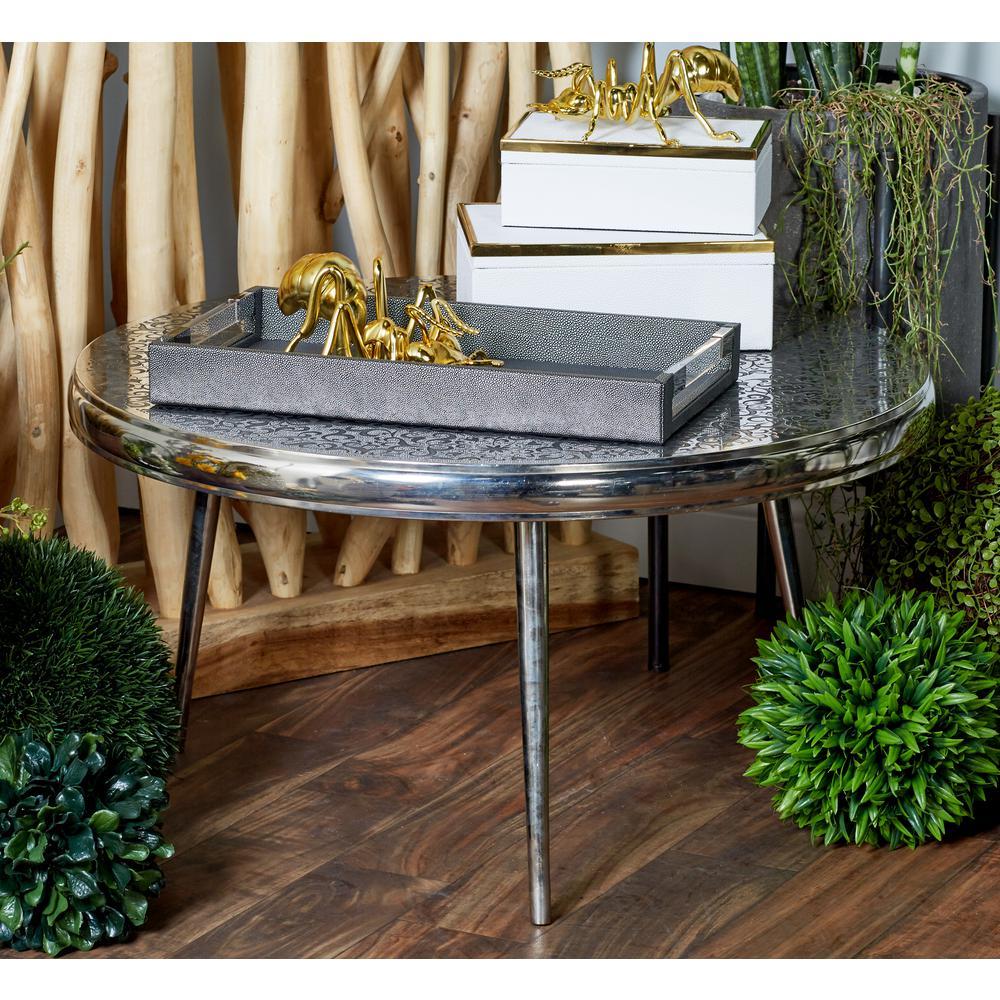 Litton Lane Silver Round Stencil Designed Coffee Table With Black Accents