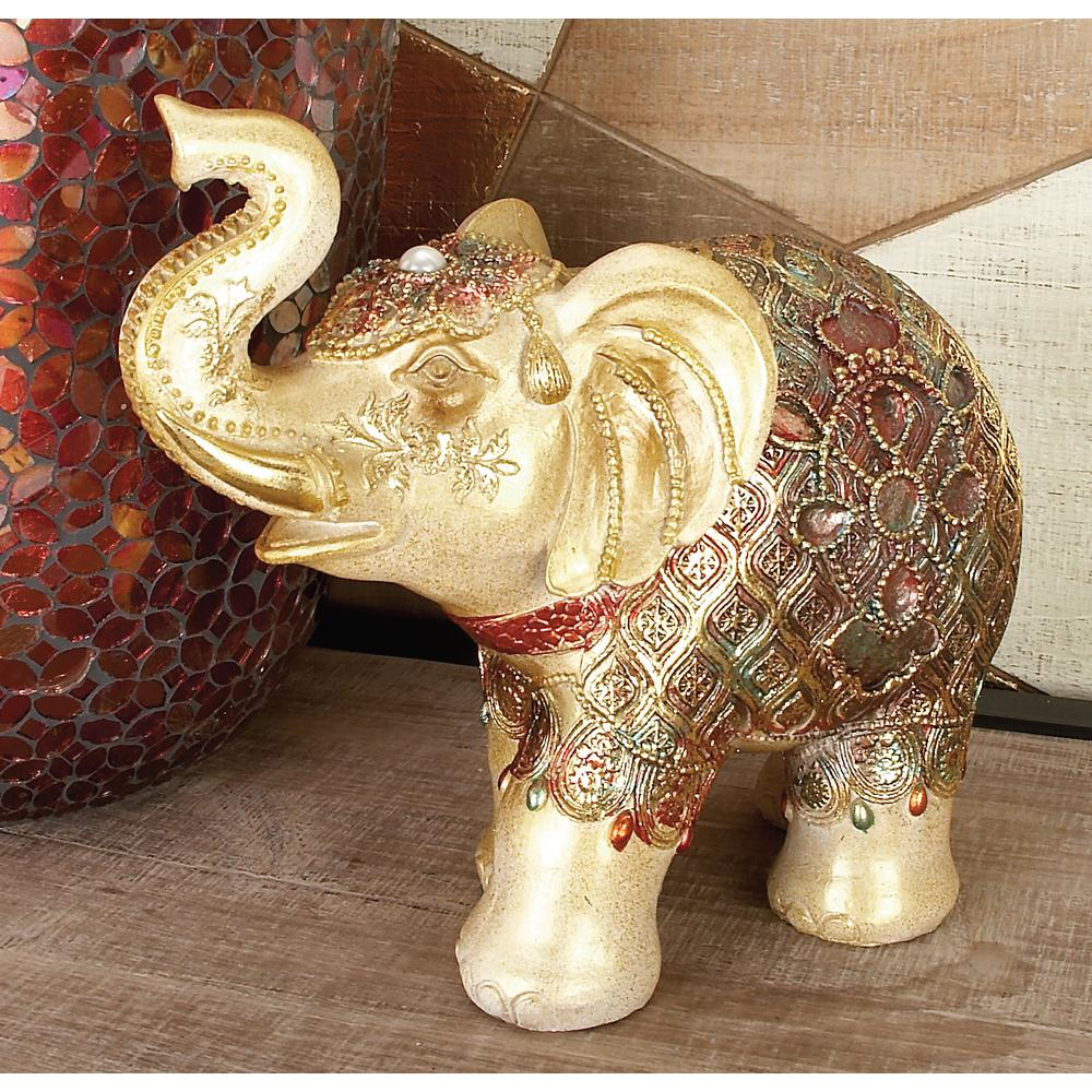 LittonLane Litton Lane 9 in. Polystone Standing Elephant with Blanket, Headdress, and Jewels Sculpture, Gold