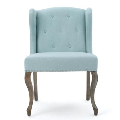 Niclas Button Back Light Blue Fabric Winged Chair with Stud Accents