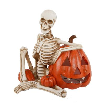 9 in. x 7 in. Halloween Lighted Polyresin Skeleton and Orange Pumpkin with Color Changing LED Lights