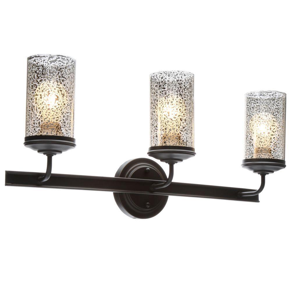 Sea gull lighting sfera 3 light autumn bronze wall bath vanity light with mercury glass 4410403 for Home depot bathroom lighting bronze