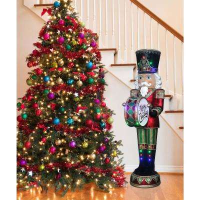6 ft. Christmas Nutcracker Playing Bass Drum with Moving Hands, Music, Timer, and 32 LED Lights