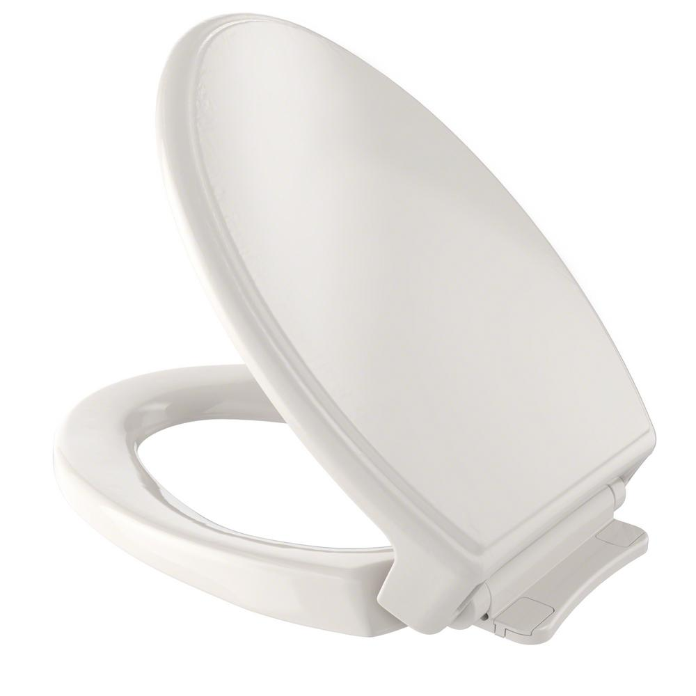 ivory toilet seat soft close. Traditional SoftClose Elongated Closed Front Toilet Seat  Beige Seats Toilets Bidets The Home Depot