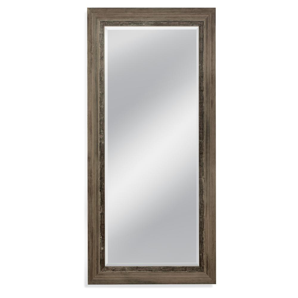 Bassett Mirror Company Nevin Leaner Mirror Sophistication in such a simple way. The Nevin Leaner mirror of all natural wood with a rustic brown finish can be used in a setting that enhances it's surroundings. This is an unforgettable addition that gives a beautiful since of depth to a room setting.