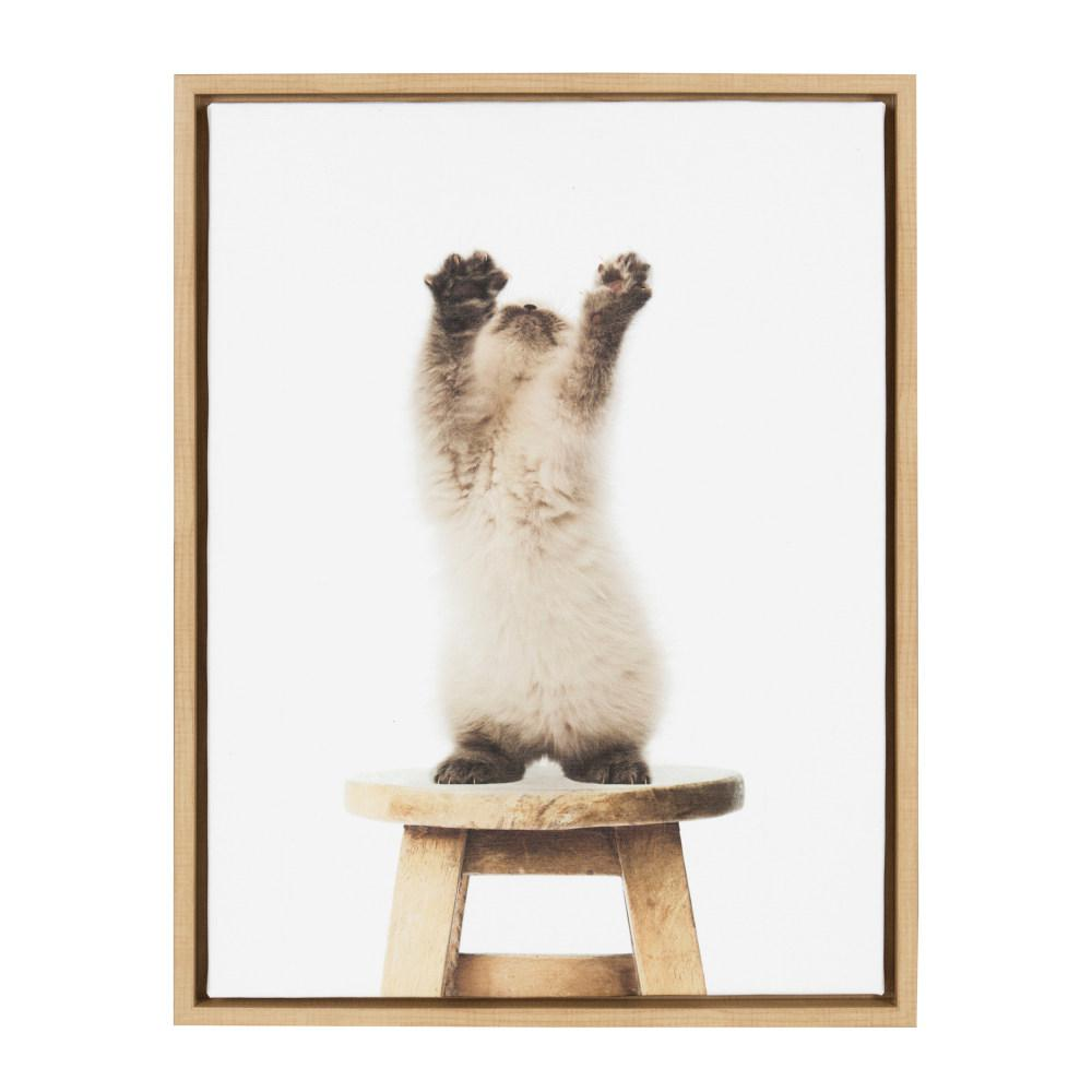kate and laurel sylvie cat stretch on chair by amy peterson framed