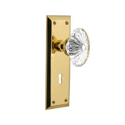 New York Plate with Keyhole 2-3/4 in. Backset Unlacquered Brass Privacy Oval Fluted Crystal Glass Door Knob in
