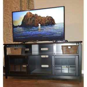 60 in wood television stand in black with 200 lb weight capacity