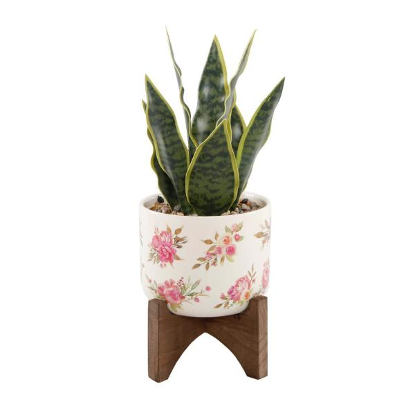 12 in. Faux Snake Plant in Flower Print White Ceramic Pot on Wood Stand