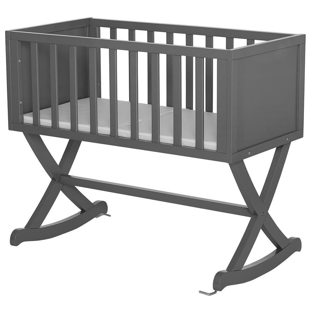 Dream On Me Luna Steel Grey Cradle Dream On Me Haven cradle creates a cozy nest-like surrounding for your newborn. This cradle offers a simple and modern design by incorporating straight lines, a solid side panel with soft mattress pad and a x-cross base which allows parents to gently rock their babies to sleep. The Haven is essential to a chic loft nursery by just adding neutral tones combined with gold accents, sophisticated iron decors and pops of geometric prints which inspires a plush, peaceful, all-night comfort. Color: Steel grey.