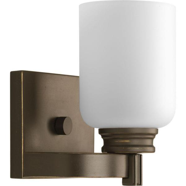 Orbit Collection 1-Light Antique Bronze Bath Sconce with Opal Etched Glass Shade