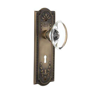 Meadows Plate with Keyhole 2-3/8 in. Backset Antique Brass Privacy Oval Clear Crystal Glass Door Knob