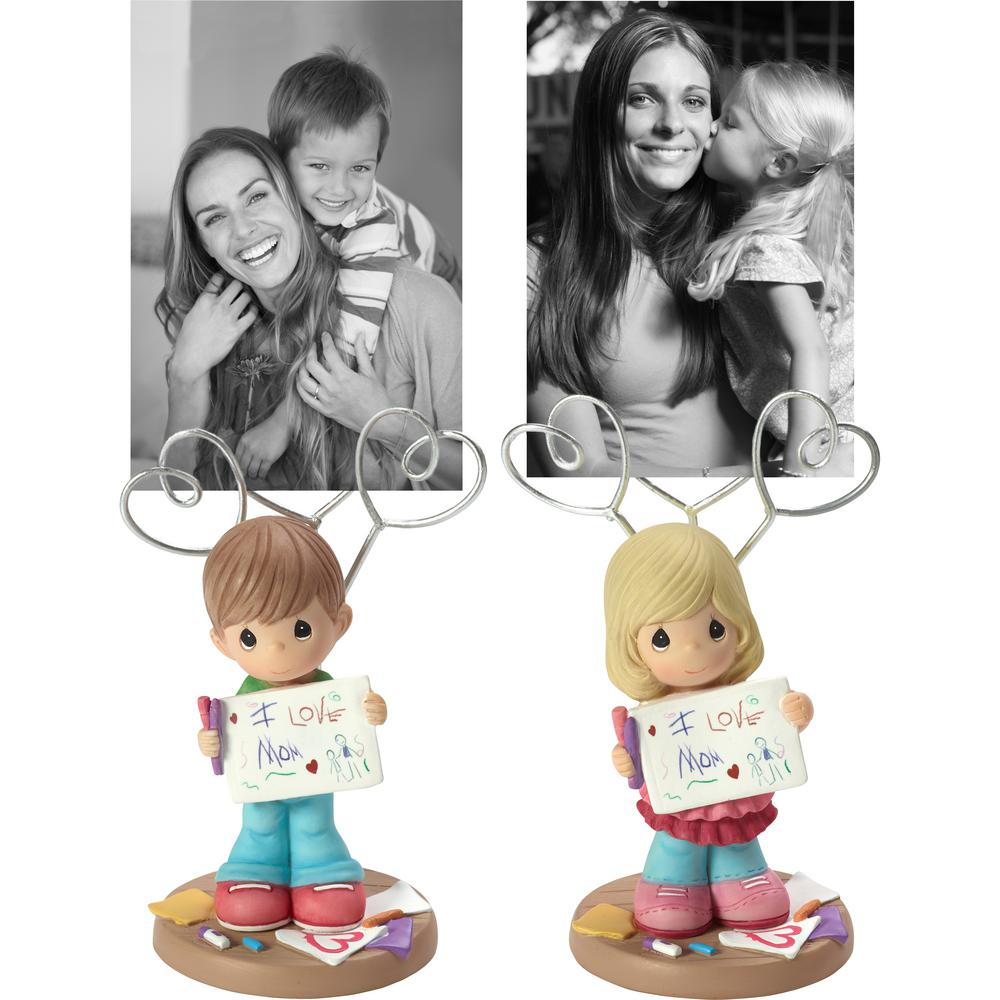 Precious Moments Multi Colored Resin Girl/Boy Holding Masterpiece Picture Holder (Set of 12) Move over refrigerator magnets, introducing a better way to display childhood masterpieces and photos, Holding up his newest masterpiece, this artistic young boy/girl proudly shows off his/her creation. Use the wire hearts above his/her head to display a multitude of mementos on this clever wire photo/art holder. Parents, grandparents, teachers so many would appreciate this gift that is perfect for holding a little ones artwork, photos, letters or other keepsakes. A memorable thinking of you gift for occasions like Mothers Day, Fathers Day, birthdays, holidays or even just because. Crafted in cold-cast resin and wire and carefully hand painted. Approximately 5.5 in. high. Color: Multi.