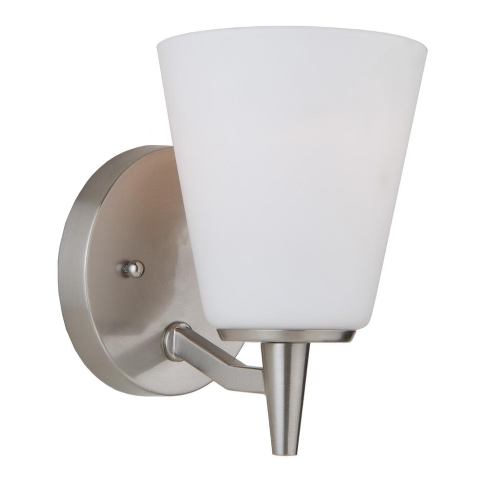 ARTCRAFT Clayton 1-Light Brushed Nickel Sconce Plated in a rich brushed nickel finish, complimented by frosted white glassware, the wall sconce from the  Clayton  collection is clean and precise.