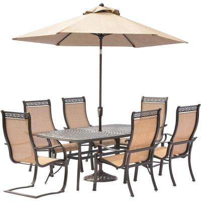 Manor 7-Piece Aluminum Rectangular Outdoor Dining Set with 2 Spring Sling Chairs, Cast-Top Table, Umbrella and Base