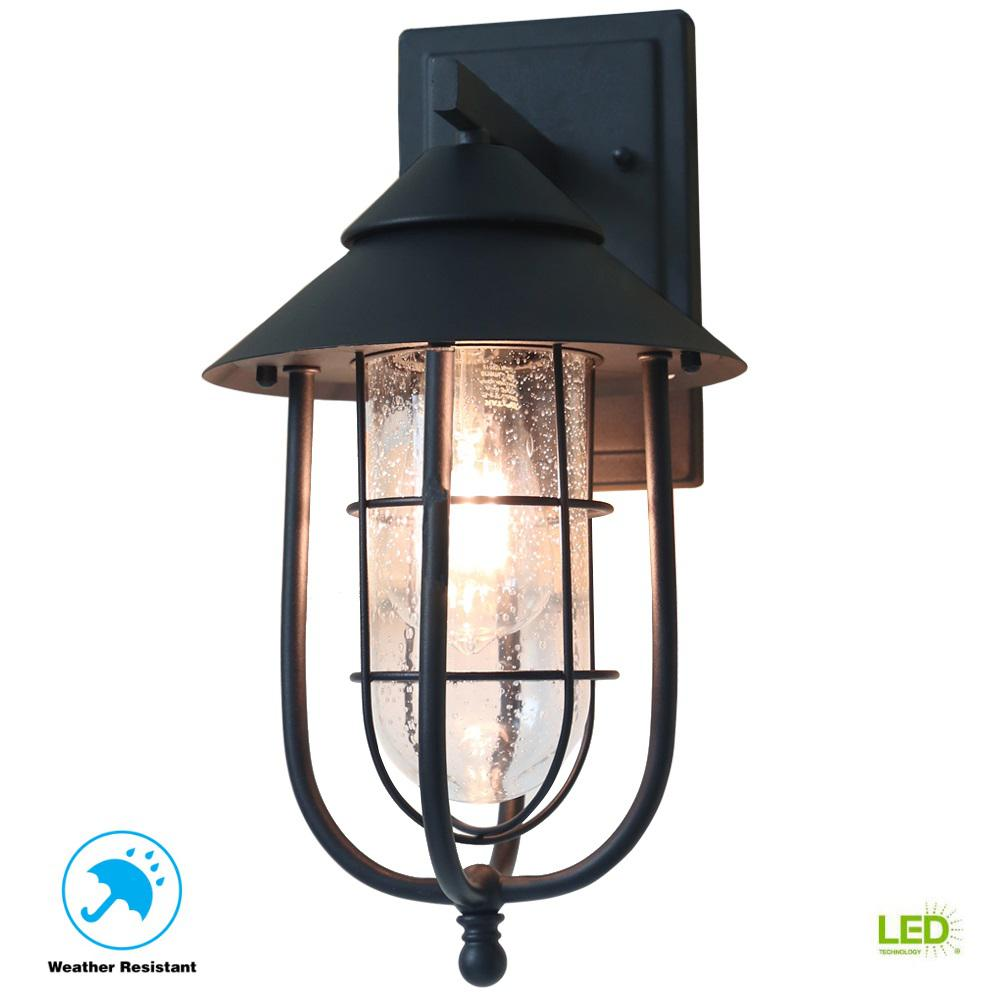 Home Decorators Collection Wisteria Collection 1-Light Sand Black Outdoor Wall Lantern Sconce with Clear Glass Shade