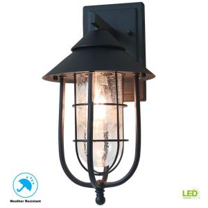 Wisteria Collection 1-Light Sand Black Outdoor Wall Lantern Sconce with Clear Glass Shade