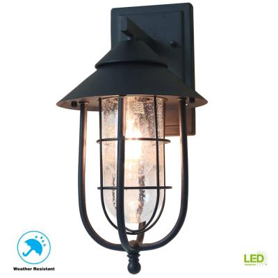 Home Decorators Collection Wisteria Collection 1 Light Sand Black Outdoor Wall Lantern Sconce With Clear Glass Shade 17699 The Home Depot