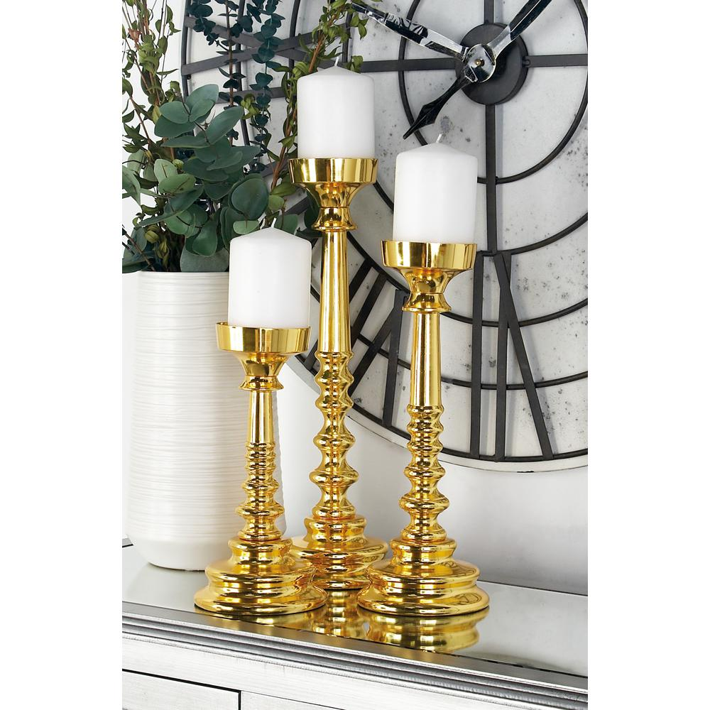 Litton Lane Gold Aluminum Candle Holders (Set of 3)