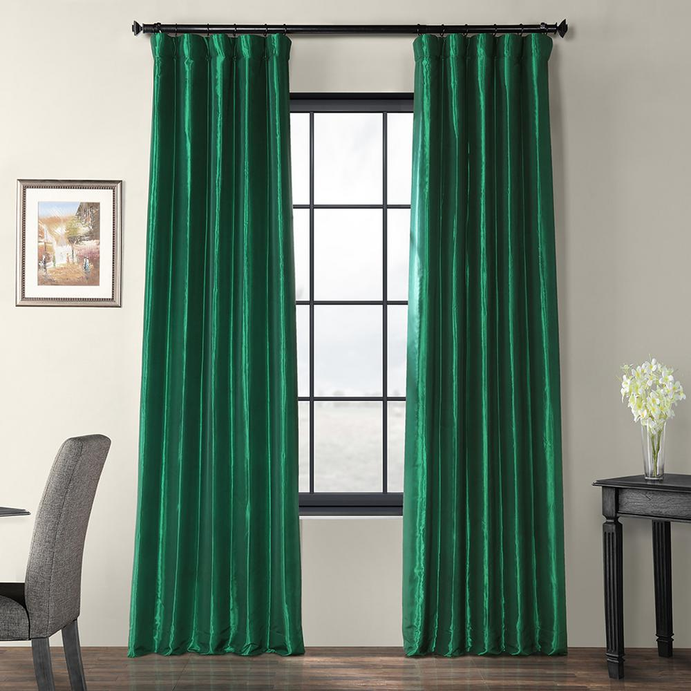 Exclusive Fabrics & Furnishings Emerald Green Faux Silk Taffeta Light Filtering Curtain - 50 in. W x 84 in. L Characterized by a smooth texture with a medium sheen, our faux silk taffetas have the look and feel of the real thing. Suitable for all decor projects. Woven 56% nylon and 44% polyester. Color: Emerald Green.