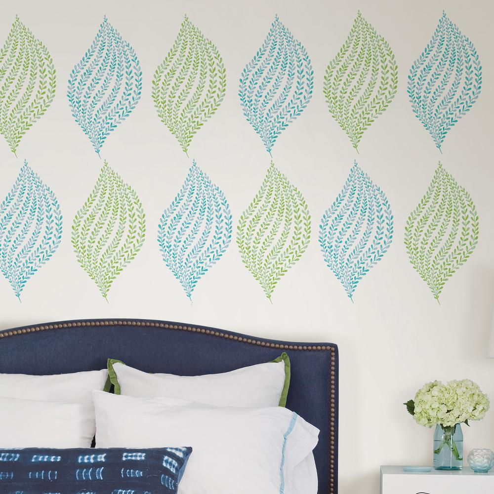 Wall Pops Blue Leaf It to Me Wall Art Kit This wall art kit will add a botanical, coastal feel to a room. Individual leaf decals allow you to create any arrangement. Leaf It To Me Wall Art Kit contains 12-pieces on 2-sheets that measure 17.25 in. x 39 in. Color: Blue.