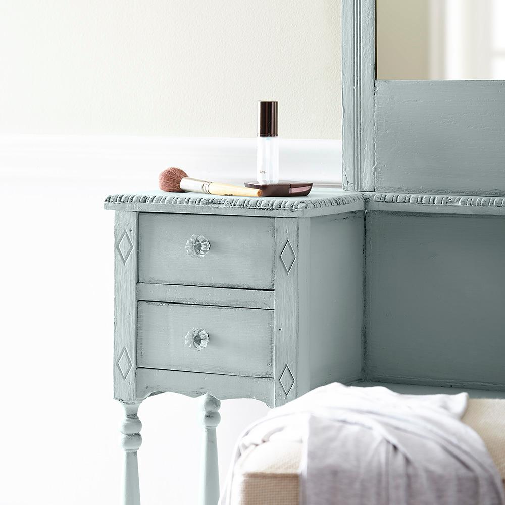 Antique blue chalk paint on a vintage dresser for a timeless and tranquil look.