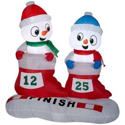 4 ft. H Airblown Snowman in Stocking Races-SM