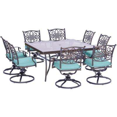 Traditions 9-Piece Aluminum Outdoor Dining Set with Square Glass-Top Table and Swivel Chairs with Blue Cushions