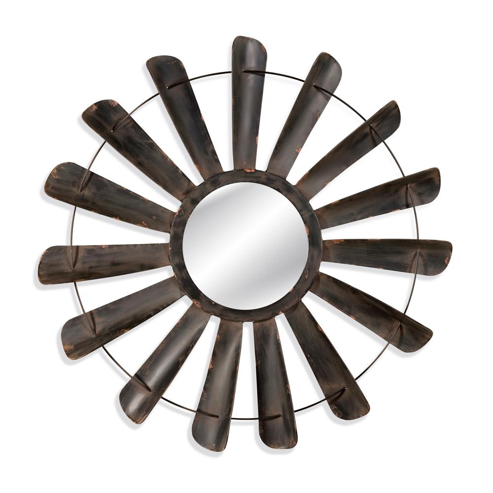 BASSETT MIRROR COMPANY Nolan Decorative Wall Mirror Bassett Mirrors Nolan Wall Mirror resembles an old factory fan that's been re-purposed. The antique iron finish provides this industrial piece with a weathered look. This item works great to create an industrial look.