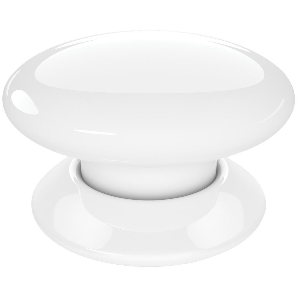 Button Multicontroller in White With a simple tap, the Apple HomeKit-Enabled Button Multicontroller from Fibaro lets you control various HomeKit-enabled devices such as lighting, fans, window shades and locks. You can also run scenes, triggering them with 1 tap, 2 taps or by holding the button down. You can conveniently place or mount the Button anywhere in your house, such as a bedside table, kid's room or kitchen counter. As the Button comes in different colors, such as this white one, it makes it easy to assign family members individual buttons programmed with their own personal commands.