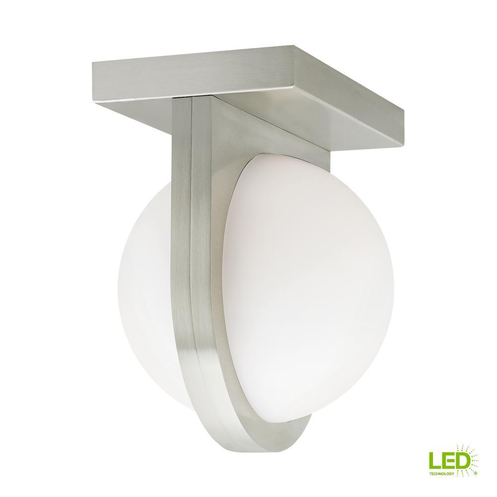 LBL Lighting Capture 24-Watt Satin Nickel Integrated LED Flush Mount In the Capture ceiling light from LBL Lighting, a gently diffused orb of LED light is held captive by a band extending from the fixture's sleek, contemporary metal body. Can also be mounted as a wall sconce vertically or horizontally. Dimmable with a low-voltage electronic dimmer.