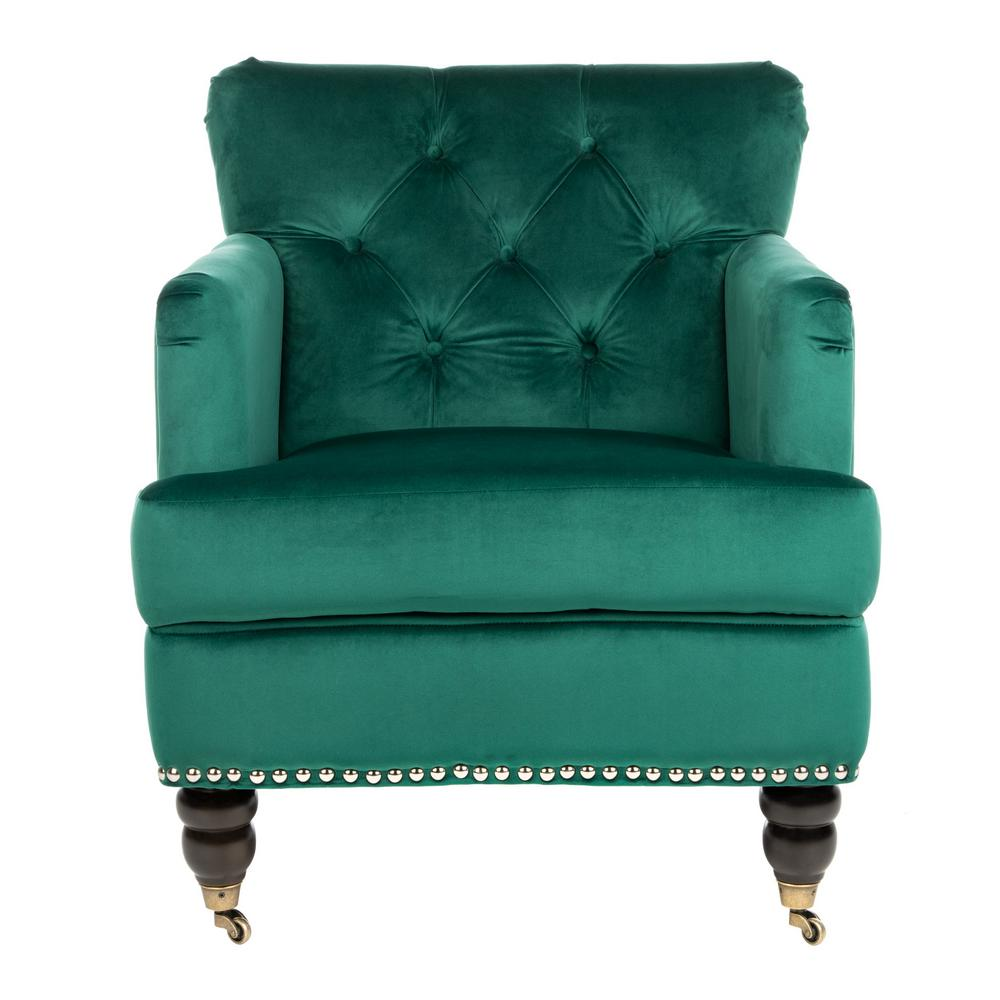 Safavieh Colin Emerald/Espresso Accent Chair Evoking classic elegance, the Colin club chair in emerald velvet upholstery is a timeless design that complements traditional and transitional furnishings. Inviting in the living room and cozy in the bedroom, Colin is crafted with plush seat cushion, designer details from button tufting to silver nail head trim and birch wood legs finished in espresso. This is a great addition for your home whether you live in the country side or the busy city. Color: Emerald/Espresso.