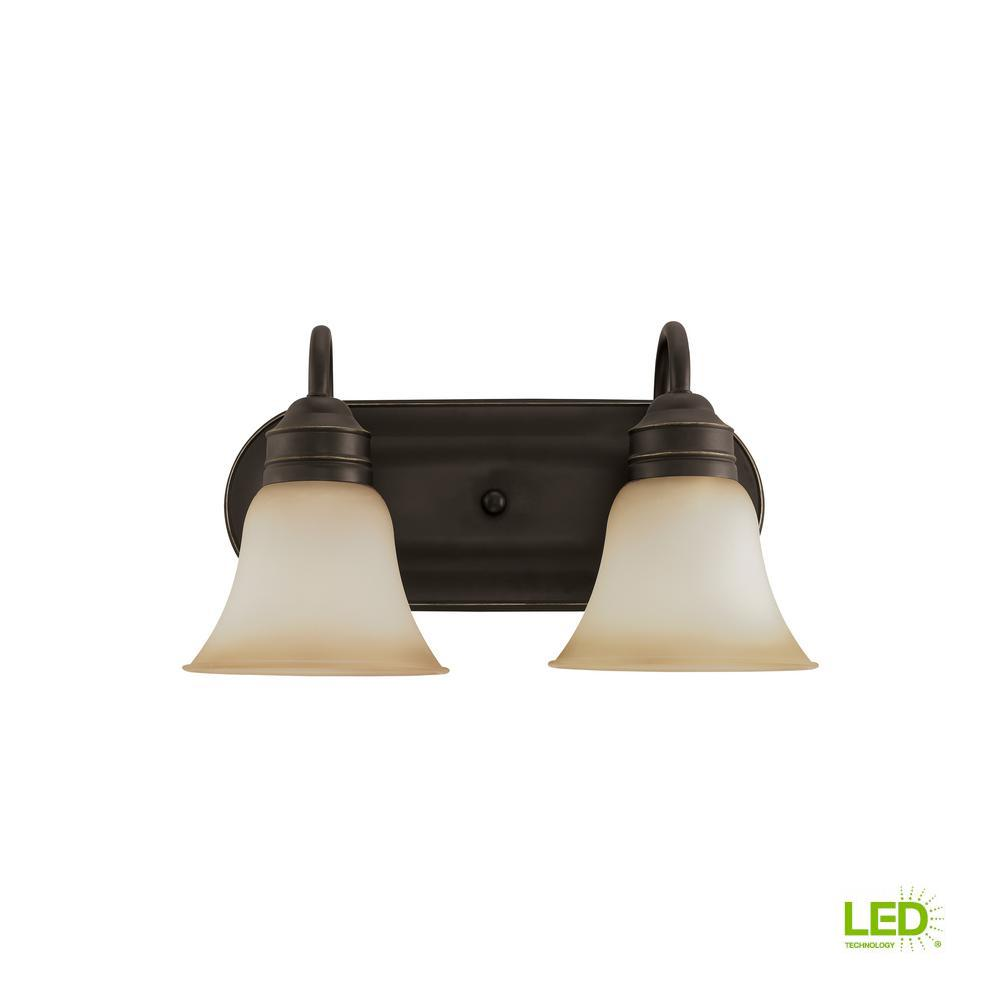 on sale be9db 03f08 Sea Gull Lighting Gladstone 2-Light Heirloom Bronze Bath Light with LED  Bulbs