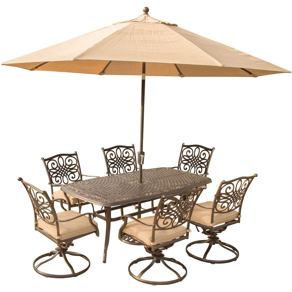 Hanover 7-Piece Outdoor Dining Set with Rectangular Cast Table and Swivels with Natural Oat Cushions, Umbrella and Base