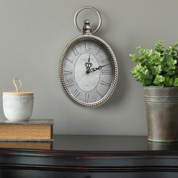 Stratton Home Decor Antique Silver Oval Wall Clock S09595