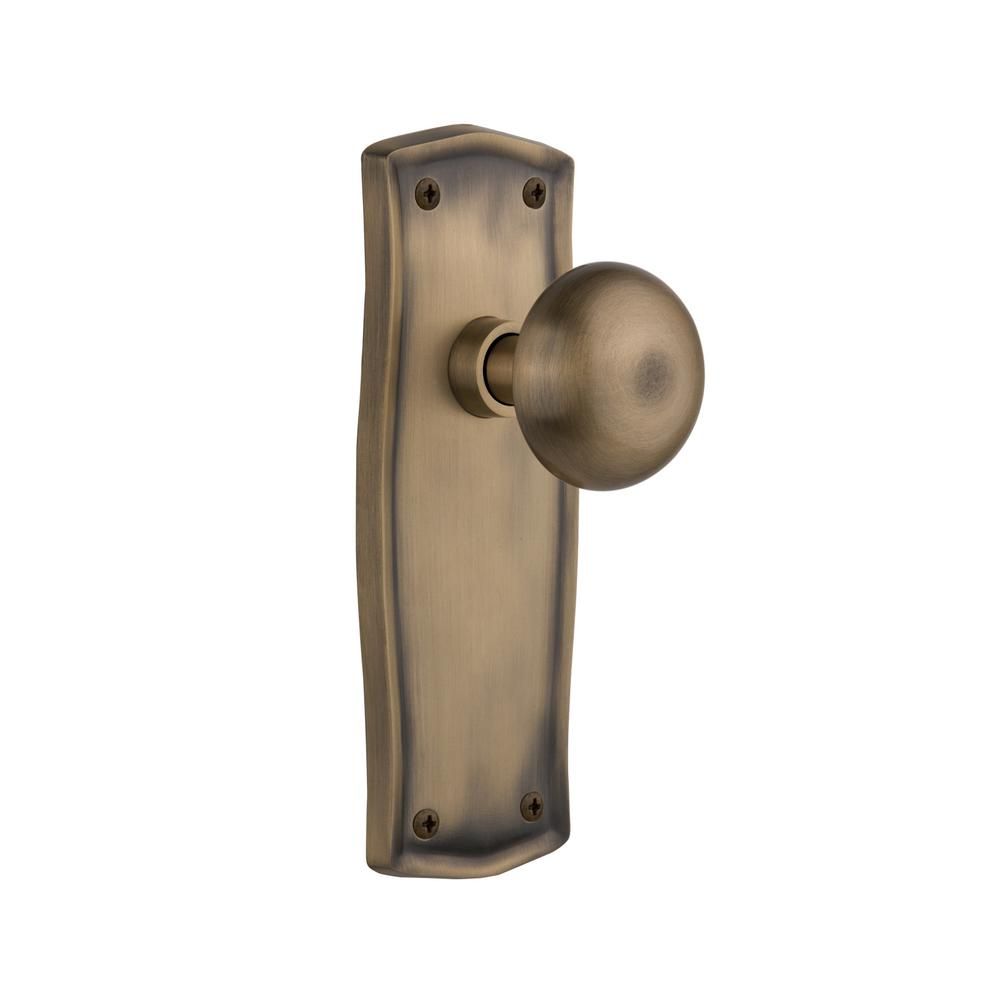 Prairie Plate 2-3/8 in. Backset Antique Brass Passage New York Door Knob
