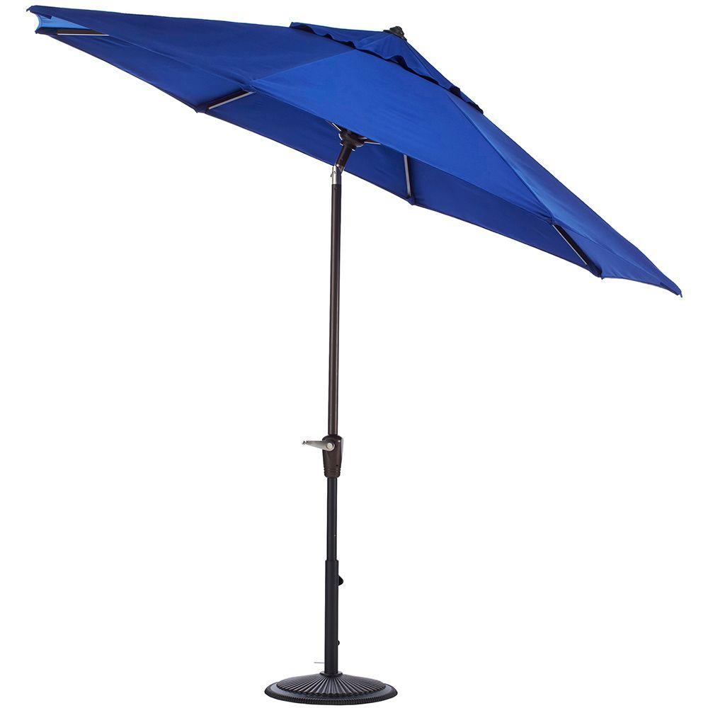 Home Decorators Collection 9 ft. Auto-Tilt Patio Umbrella in Blue Sunbrella with Black Frame