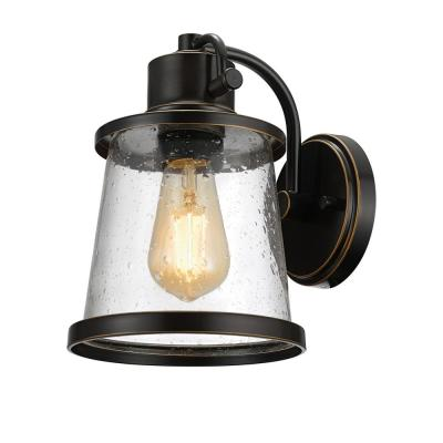 Charlie Collection 1-Light Oil-Rubbed Bronze LED Outdoor Wall Sconce with Clear Seeded Glass Shade, LED Bulb Included