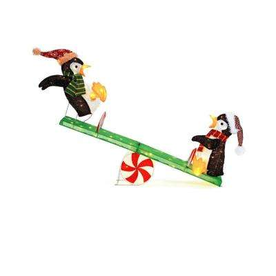 led lighted tinsel penguins on seesaw