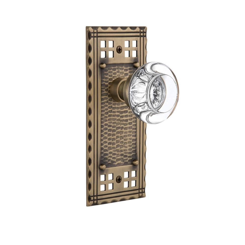 Nostalgic Warehouse Craftsman Plate 2-3/8 in. Backset Antique Brass Privacy Bed/Bath Round Clear Crystal Glass Door Knob
