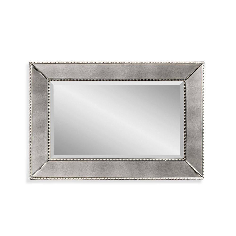 BASSETT MIRROR COMPANY Beaded Decorative Wall Mirror This wall mirror from BMC's Hollywood Glam collection features stunning beading along the framed edging and an antique mirror finish. The classic rectangular shape allows this piece to go well in various settings. Beautiful in any room setting.