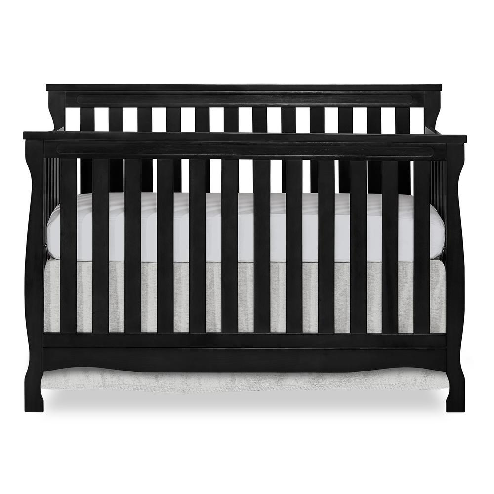 Dream On Me Keyport Black 5 in 1 Convertible Crib The Dream On Me Keyport cribs offers classic coastal deign by incorporating carved posts and classic arches match the waves of the ocean. This crib offers a long term value converting into a charming toddler bed with our conversion kit ( sold separately ), daybed and the back panel converts to a full-size headboard with the simple addition of our wooden bed frame ( sold separately). The Keyport mattress platform adjusts to three different heights depending on the age of your baby. All Dream On Me cribs meets all applicable ASTM and CPSC standards. Color: Black.