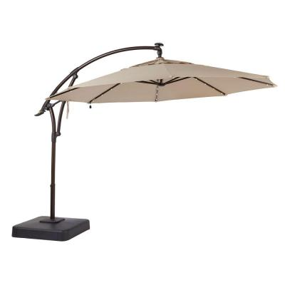 11 ft. LED Round Offset Outdoor Patio Umbrella in Sunbrella Sand