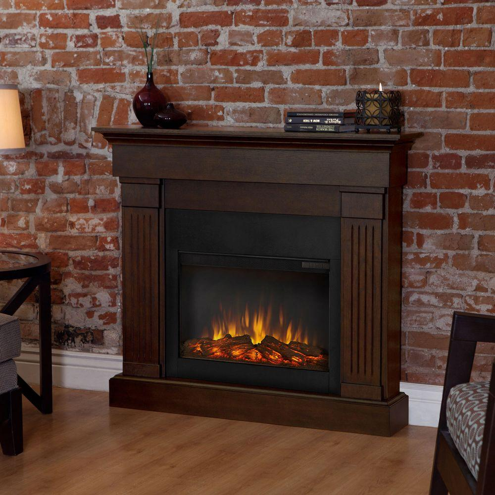 Complement your hallway and living room by choosing this Real Flame Crawford Slim-Line Electric Fireplace in Chestnut Oak.