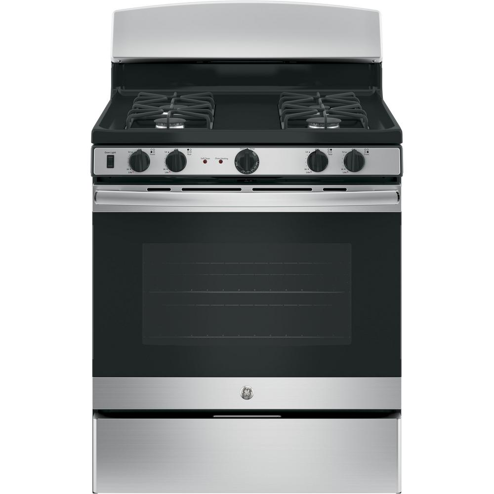 how to clean a gas oven top