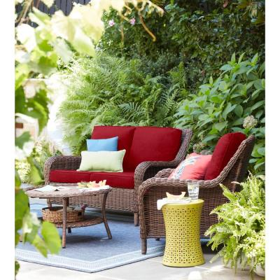 Cambridge Brown Wicker Outdoor Patio Loveseat with CushionGuard Chili Red Cushions