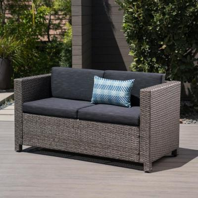 Gray Wicker Outdoor Loveseat with Mixed Black Cushion